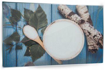 Panel szklany do kuchni - Xylitol - sugar substitute. Birch sugar on blue wooden background.