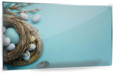 Panel szklany do kuchni -  Easter background with Easter eggs and spring flowers on blue table
