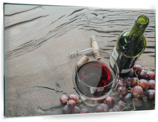 Panel szklany do kuchni - Wine glass, wine bottle and grapes on wooden background. Wine tasting.