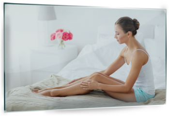 Panel szklany do kuchni - people, beauty, depilation, epilation and bodycare concept - beautiful woman touching smooth leg skin on bed at home bedroom