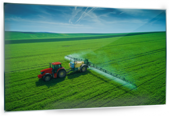 Panel szklany do kuchni - Aerial view of farming tractor plowing and spraying on field