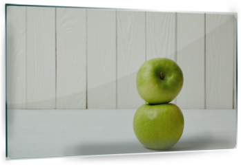 Panel szklany do kuchni - Two raw fresh green apples on wooden background with copy space