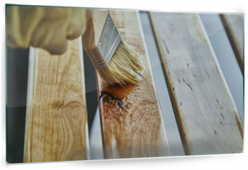 Panel szklany do kuchni - Paint Brush in a can of varnish in preparation to stain the wood slats