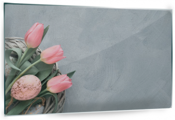 Panel szklany do kuchni - Springtime or Easter background with pink tulips and Easter eggs in wattle ring on grey concrete, text space