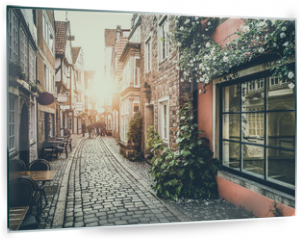 Panel szklany do kuchni - Historic street in Europe at sunset with retro vintage effect