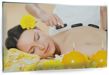 Panel szklany do kuchni - Woman Receiving Hot Stone Therapy In Spa