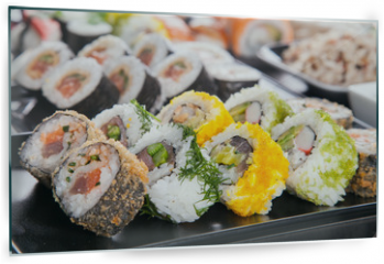 Panel szklany do kuchni - Delicious sushi pieces served on black stone