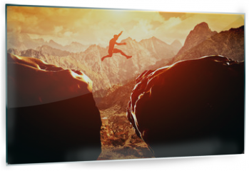 Panel szklany do kuchni - Man jumping over precipice between two mountains at sunset