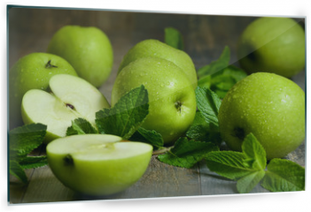 Panel szklany do kuchni - Green apples with mint leaves.