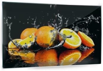 Panel szklany do kuchni - Orange fruits and Splashing water