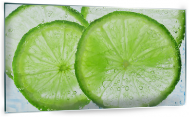 Panel szklany do kuchni - lime with bubbles isolated on white